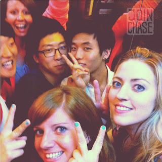 Foreigners and Koreans posing in an elevator in Ulsan, South Korea.