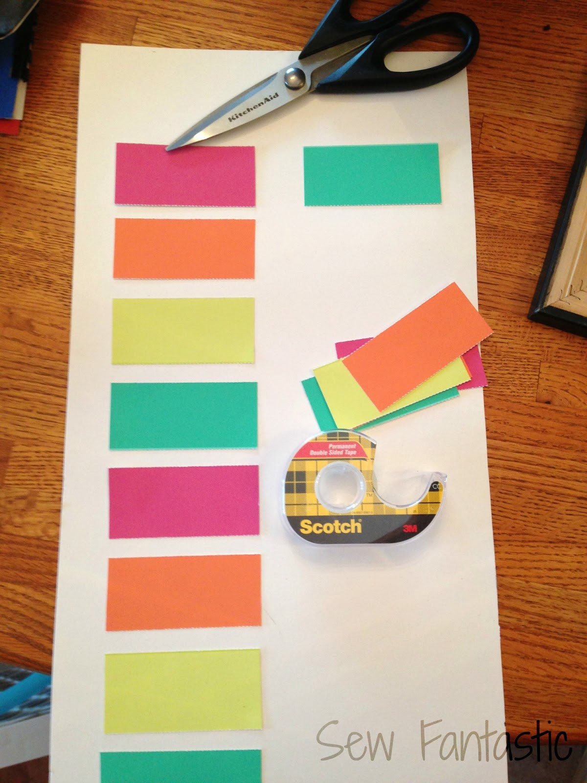 ... off the ends of the paint chips and taped them to the poster board
