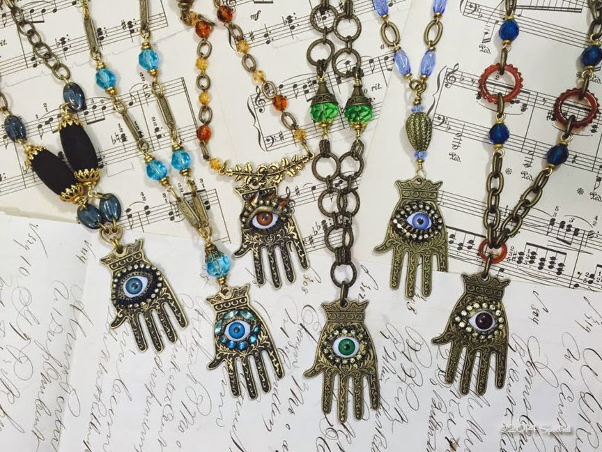 Colorful Hamsa Necklaces by Barbe Saint John