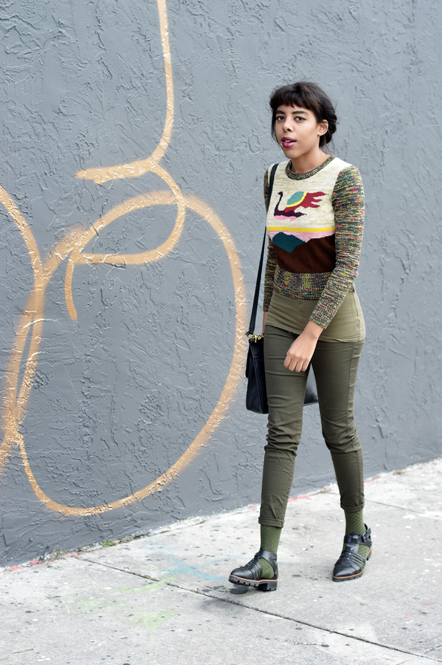 Indie Fashion Blogger Anais Alexandre of Down to Stars in an all olive green outfit walking around Wynwood