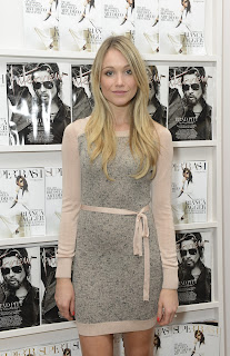 Katrina Bowden wearing a tight grey dress