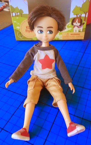 Finn Doll for boys sitting on the ground