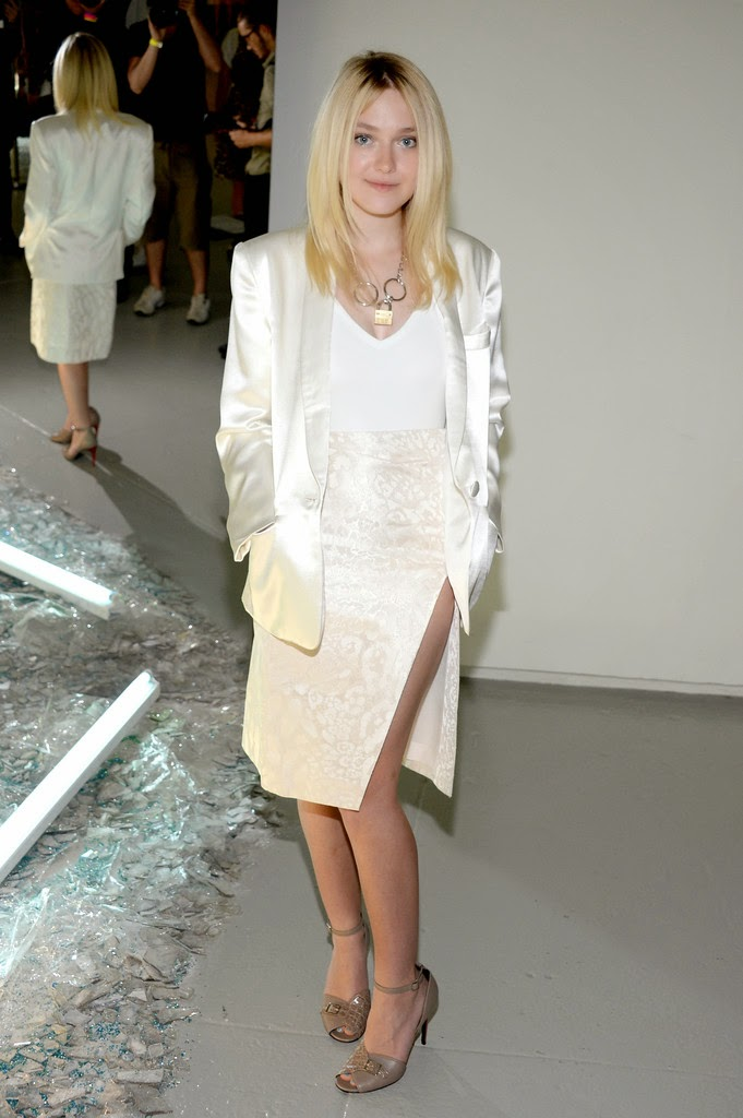 Dakota Fanning in a white ensemble at the Rodarte Spring 2015 New York Fashion Week Show