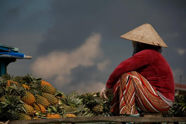 Comerciante del mercado flotante, Delta del Mekong - Vietnam.