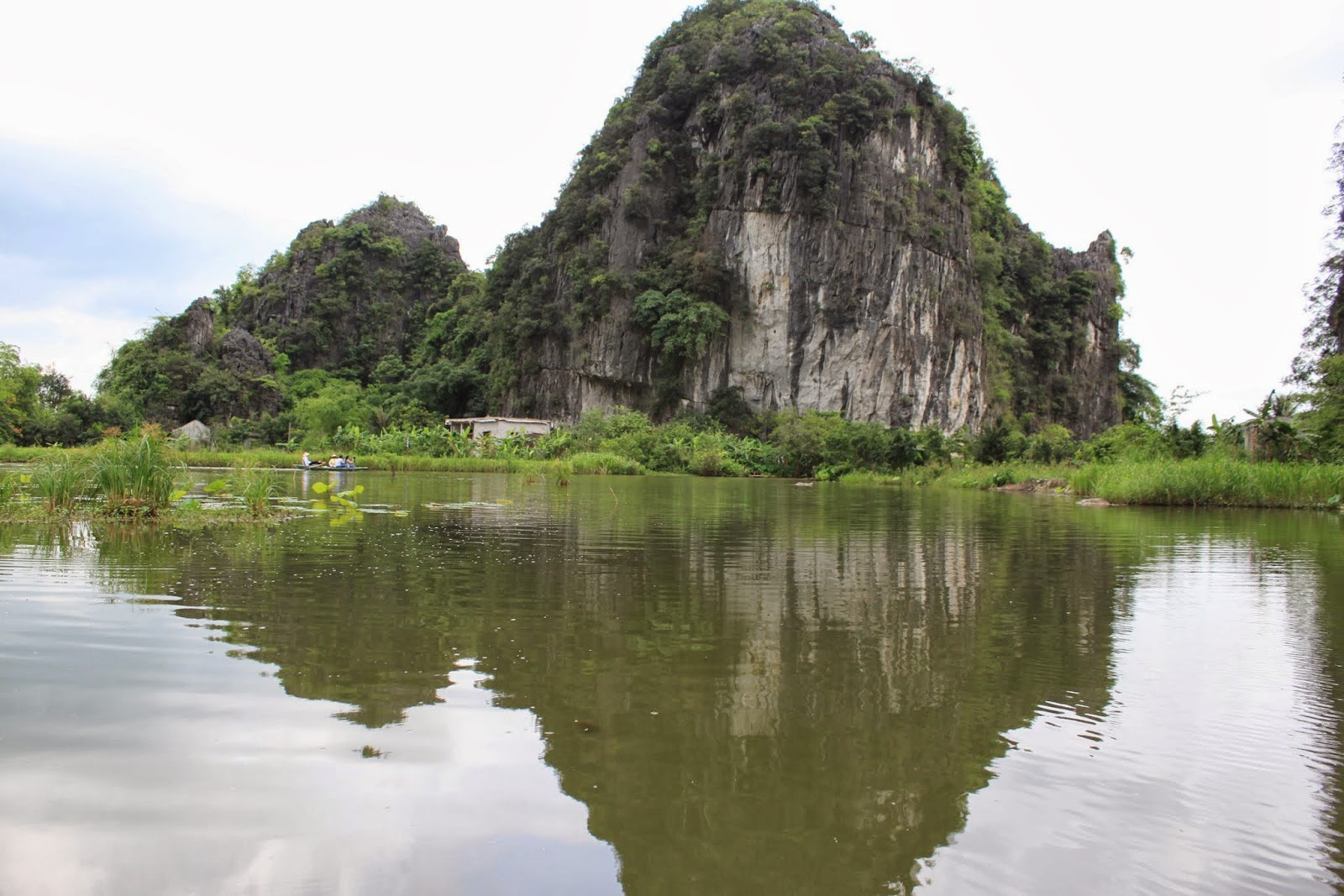 The clear mirror reflection between the cave with Ngo Dong river at Tam Coc near the city of Ninh Bình in northern Vietnam