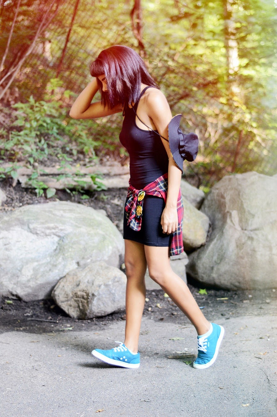 Indie Fashion Blogger Anais Alexandre of Down to Stars wears a fun bucket hat by a waterfall in her air walk shoes