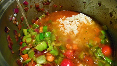Soup Pot with Liquid Being Added