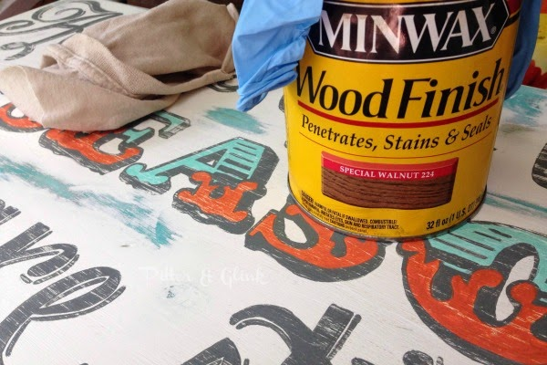 Use stain to age a freshly painted sign and give it a vintage look.  pitterandglink.com