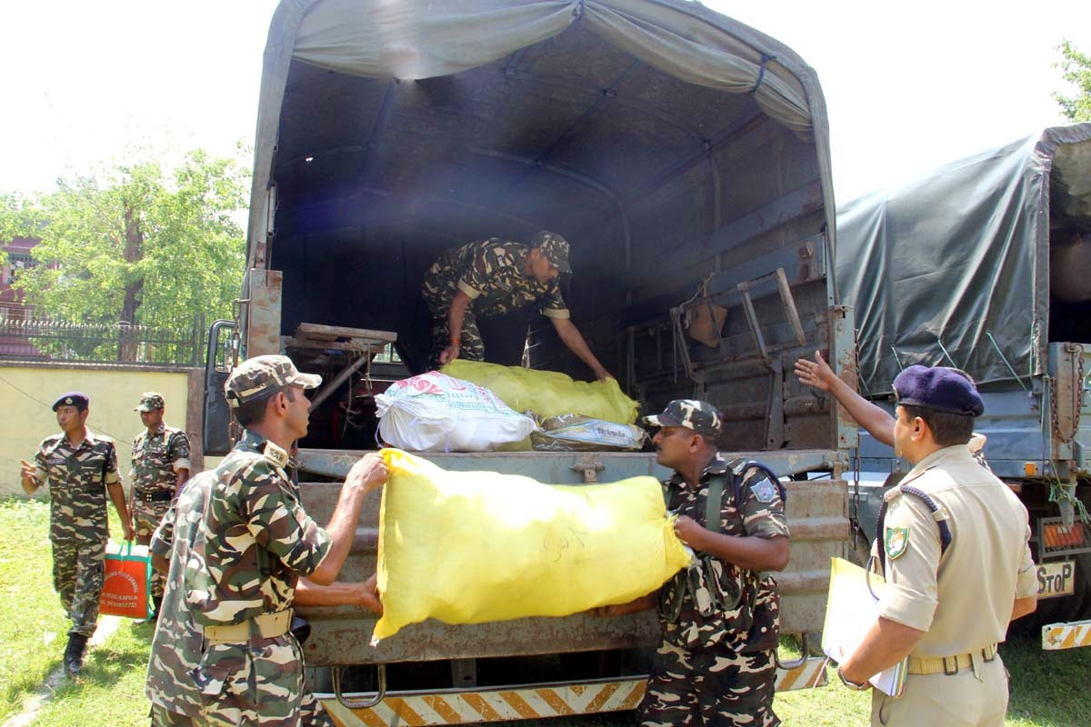 Relief materials for the Nepal earthquake victims are being loaded in the truck at SSB Ranidanga campus