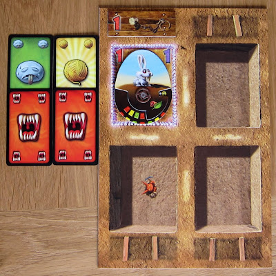 Dungeon Petz - A players Display board with a pet (Direbunny), a cage Addon and 4 Needs cards