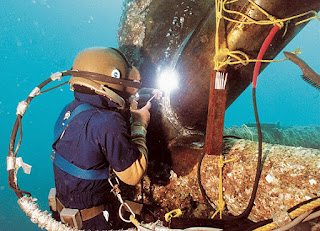 underwater welder doing his welding job