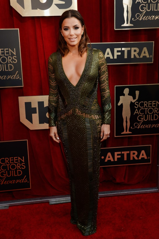Eva Longoria flashes skin at the 2016 SAG Awards in a sequinned dress