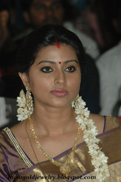 Sneha with simple Diamond haram and Diamond earrings