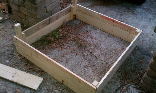 Hightail farms building raised garden beds on the cheap - Build raised garden bed cheap ...