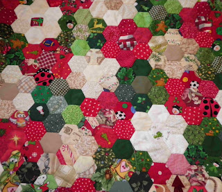 english paper piecing hexagon Christmas quilt