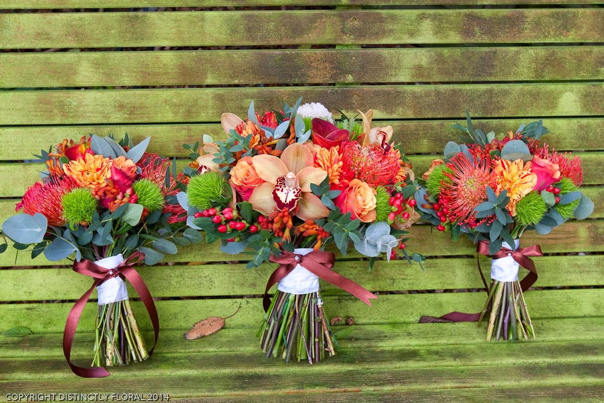 Distinctly floral kirsten and andrews autumnal wedding flowers kirstens bouquet was a lovely hand tied and very textured combination of roses protea calla lilies berries dahlia orchids and greentrick with the very mightylinksfo