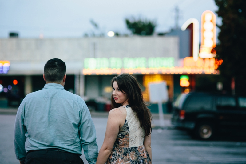 walking toward the Majestic Diner at their engagement session