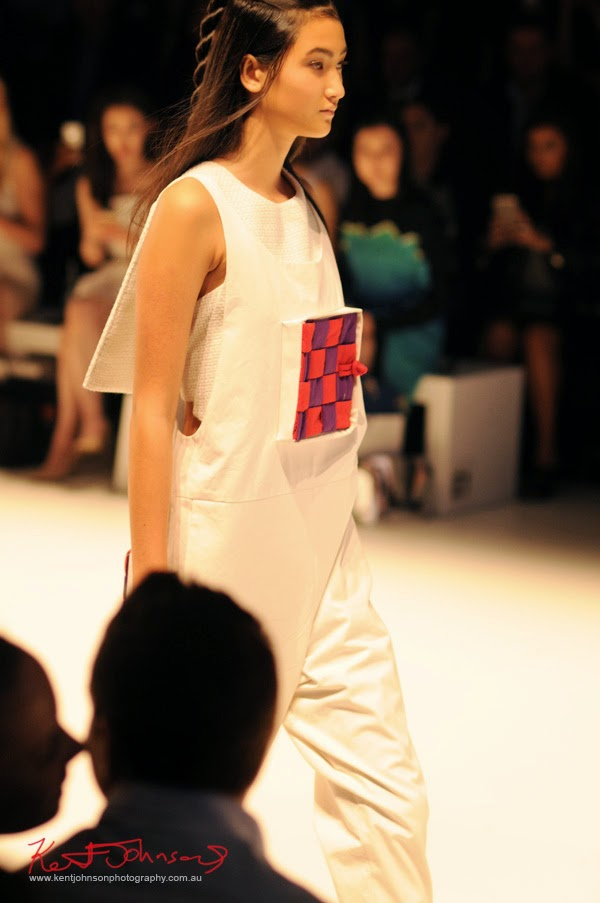 White jumpsuit with relief red/purple check panel box with door!! Matiny Ng's 580 fashion label at MBFWA Raffles International Showcase, Carriageworks Sydney. Photographed by Kent Johnson.