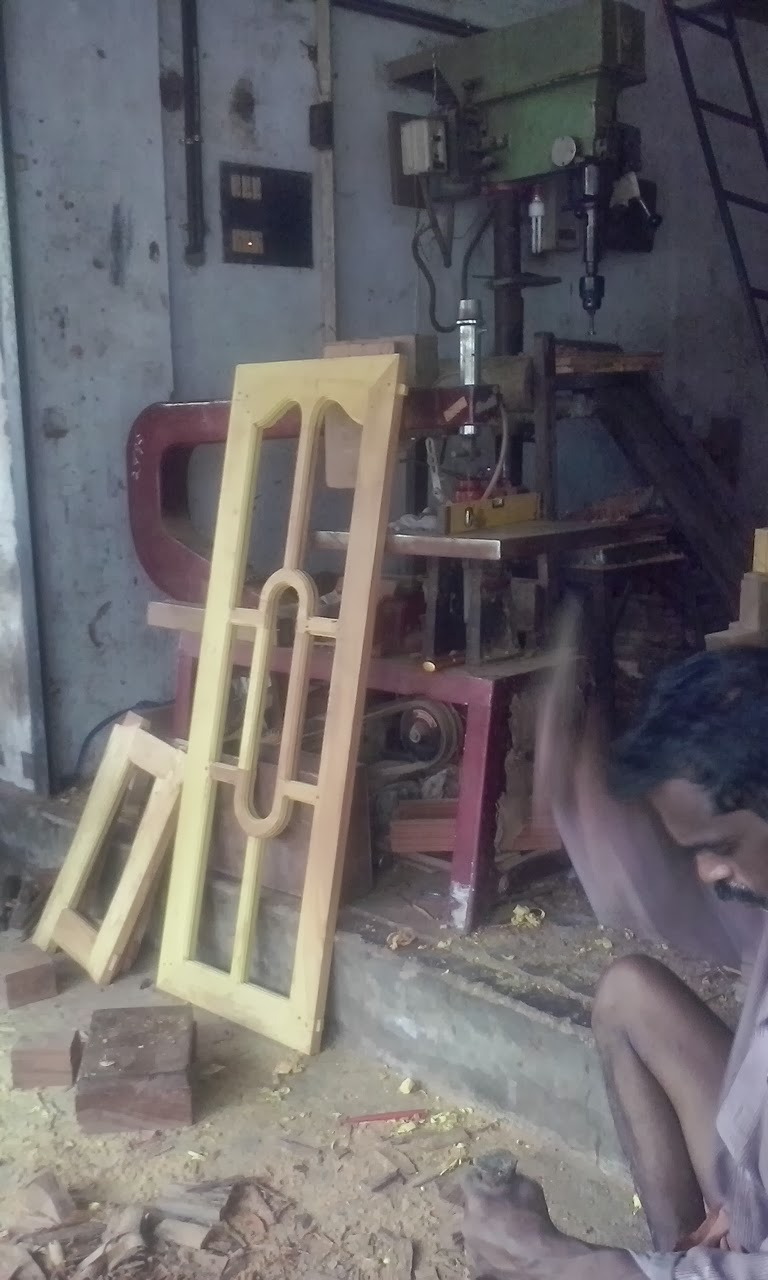 Kerala style carpenter works and designs exterior wood for Kerala home window design