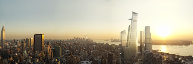 Picture of four new buildings at the sunset with Lower Manhattan in the background