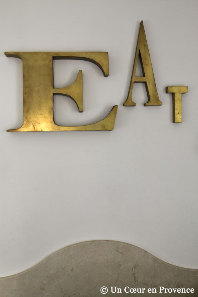 Former brass letters from a sign like a the decoration of a kitchen