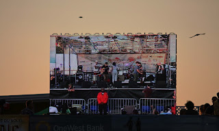 big screen view from sand, summer beach concert by lb for l&l