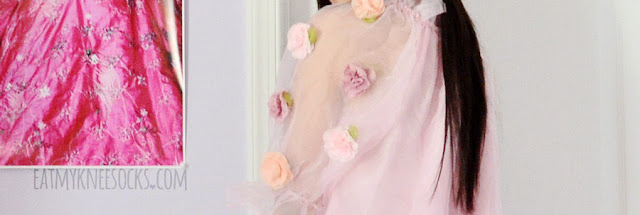 Close-up of the sheer organza floral applique dress from Romwe.