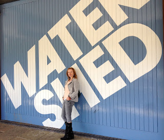 Charlotte Quickenden outside the Watershed sign