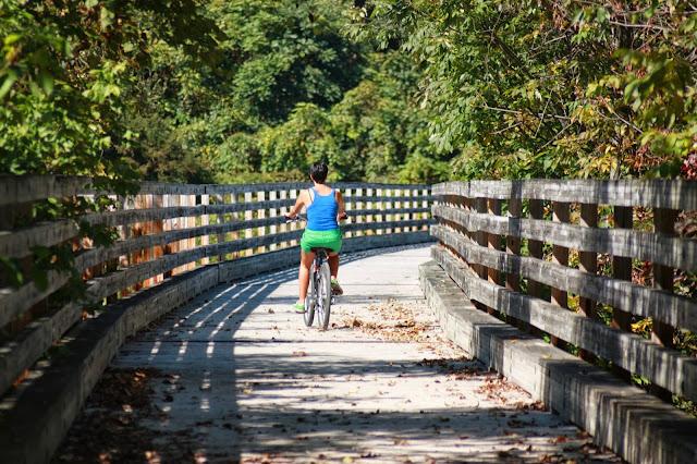 Kristina riding bike on wooden bridge