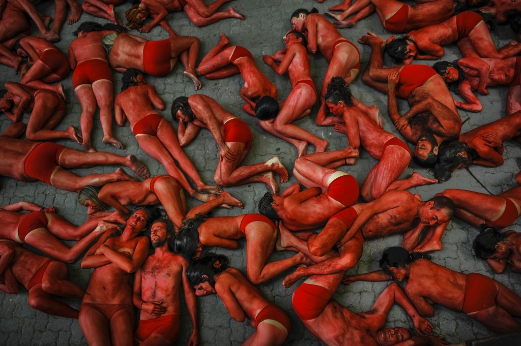 70 Of The Most Touching Photos Taken In 2015 - People protest against bull runs ahead of the beginning of the famous San Fermin Fiestas, Spain.