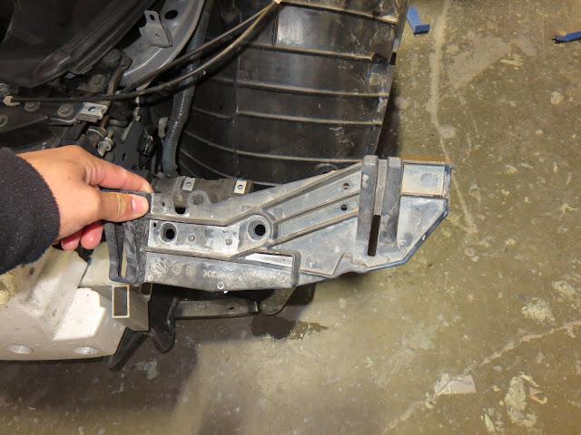 Bracket hidden inside the bodywork damaged by impact