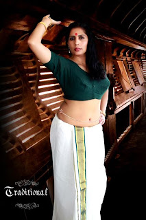 ... and producer Mini Richard hot navel and cleavage show photos in saree
