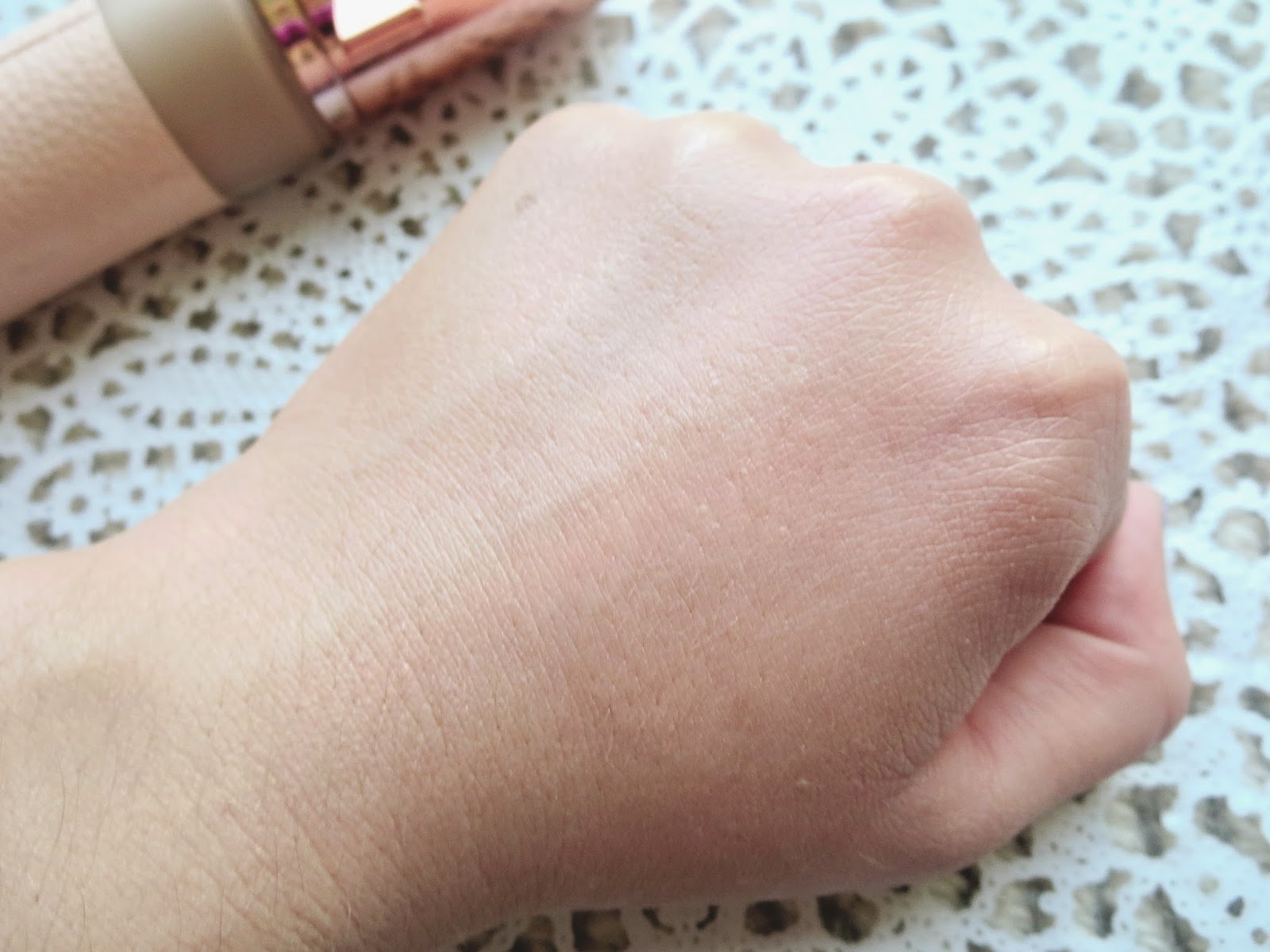 a picture of Physician's Formula Touch of Glow Foundation in Light (swatch) blended out