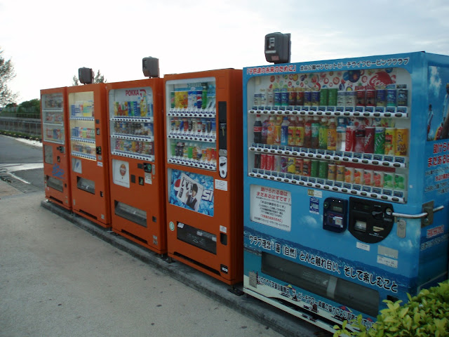 variety of japanese vending machines in a row