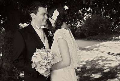 bride and groom looking at each other and smiling at a London park