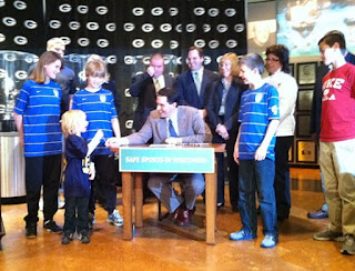 Scott Walker Signs Concussion Safety Bill