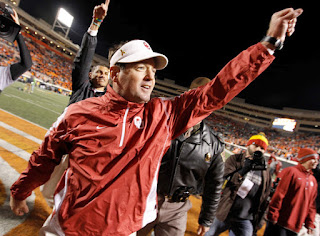 Head coach Bob Stoops of the Oklahoma Sooners celebrates after the Sooners beat the Oklahoma State Cowboys 47-41 at Boone Pickens Stadium on November 27, 2010 in Stillwater, Oklahoma. (November 26, 2010 - Source: Tom Pennington/Getty Images North America)