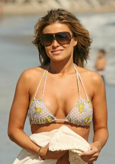 Carmen Electra Sexy Pictures Beach Bikini No tan lines on this bodybuilding woman to annoy you.