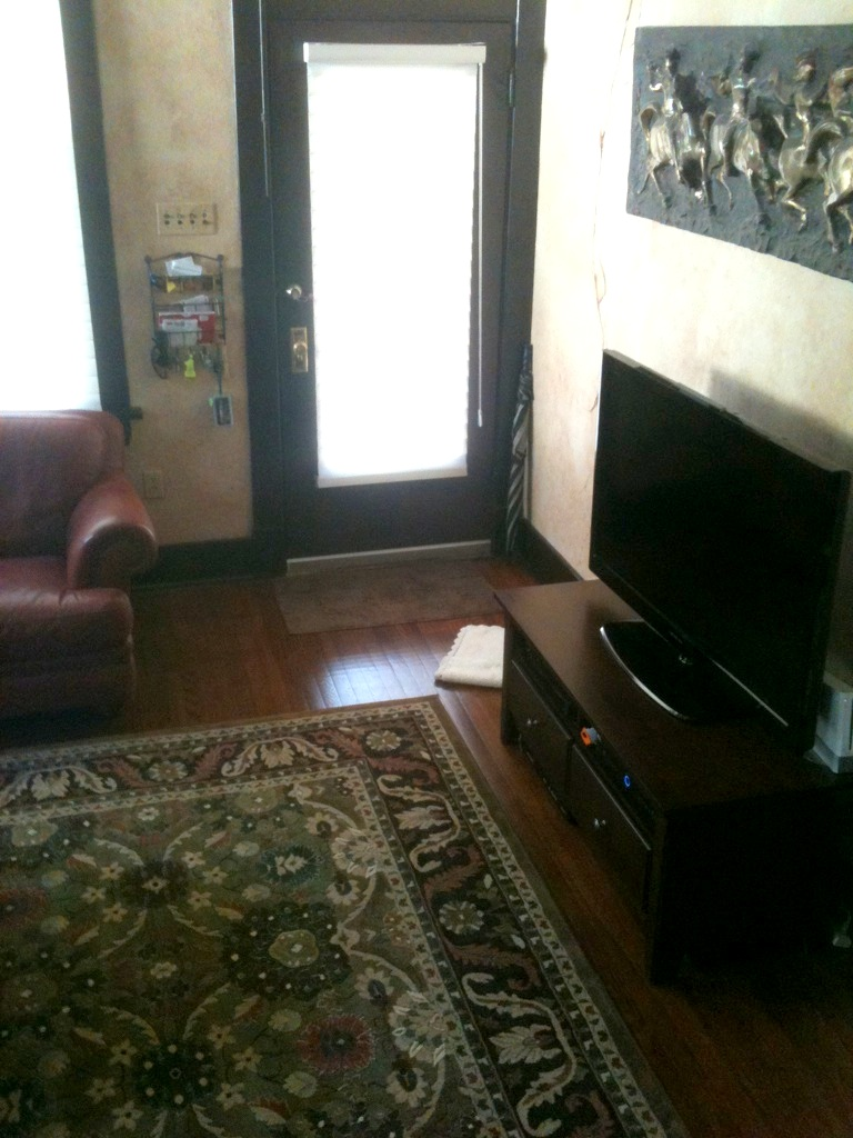 They Had Difficulty Placing The Furniture Because Room Layout Was Tricky Front Door Opens To Corner Of Living