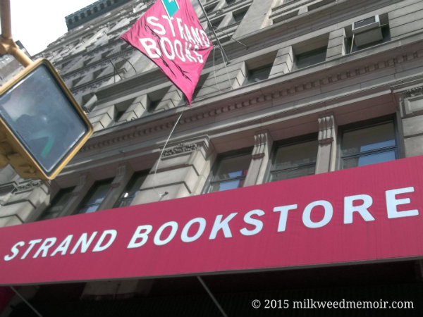 looking up at street banner for Strand Bookstore, New York City