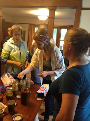 Jen McGlashen offers samples of her homemade sauces to Catskills CRAFT members