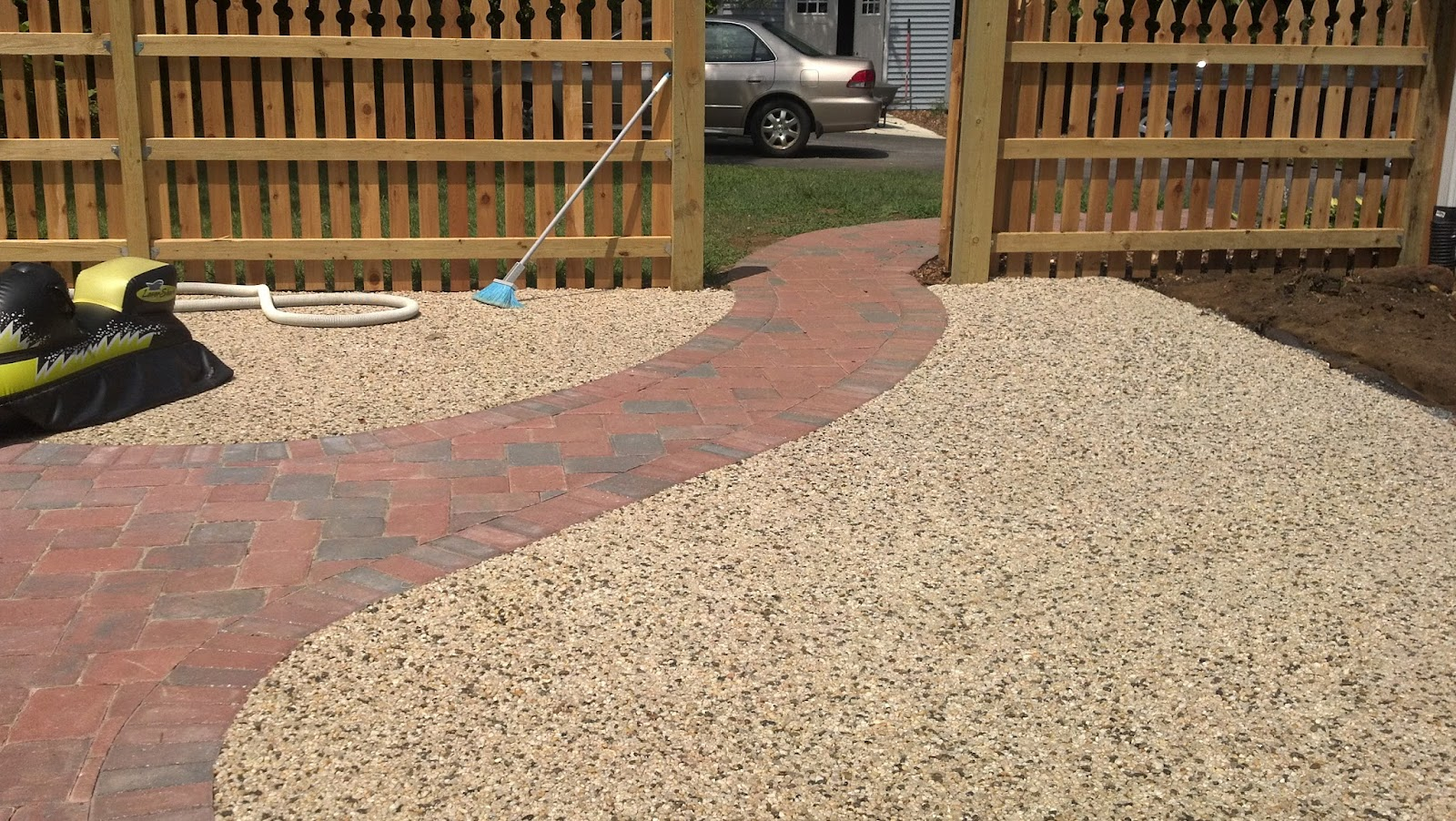 Life time pavers gravel lok whitehall pebbles around for Pebbles in backyard