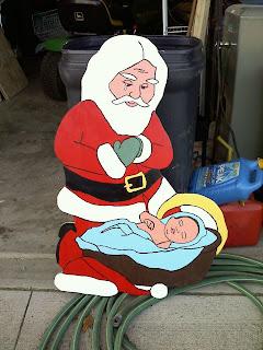 Santa Bowing down to Baby Jesus yard art