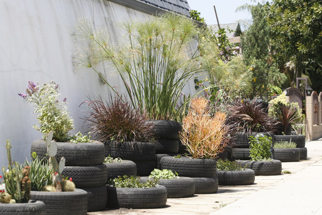 A vintage junket a man and his tires for How to use old tires in a garden
