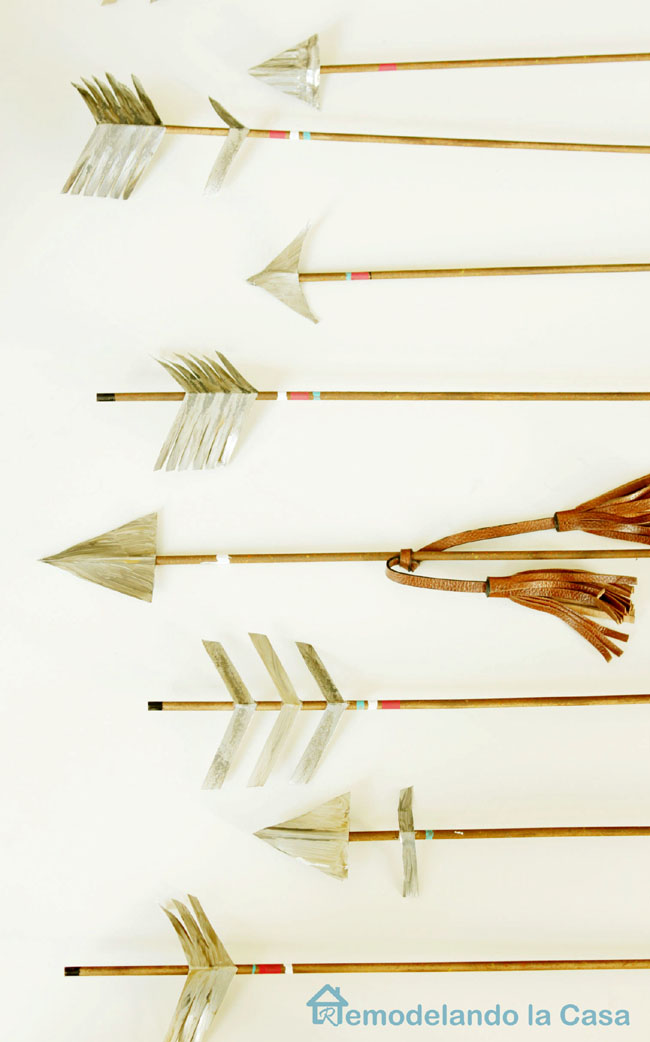 arrows made out of metal and round dowels, a craft for home decor