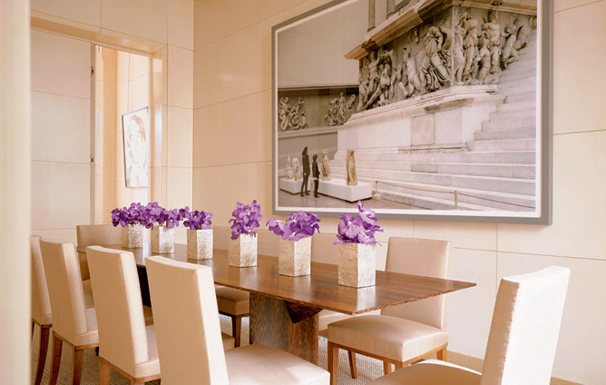 Tall Ceilinged Beige Dining Room Is Punctuated With A Splash Of Color From  The Purple Orchids On The Table, By Peter Marino