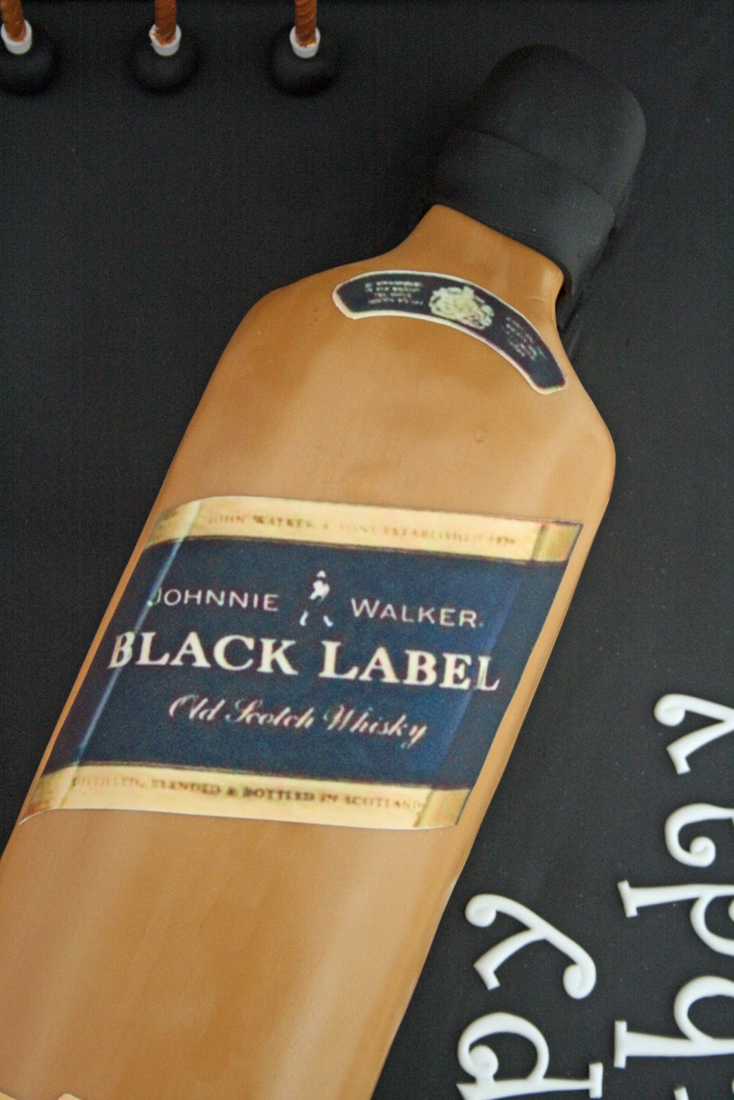 Johnnie Walker Blue Label Cake http://lauralovescakes.blogspot.com/2012/07/johnnie-walker-whiskey-bottle-cake.html