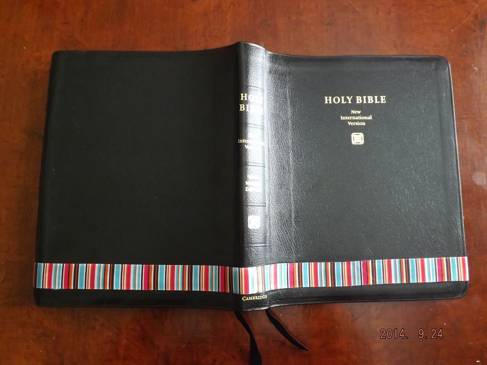 Using ribbon to cover an inscribed Cambridge Wide Margin Bible that will be used for journaling..