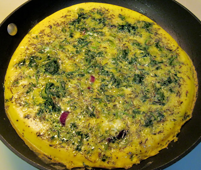 Cooking frittata with carrot leaves