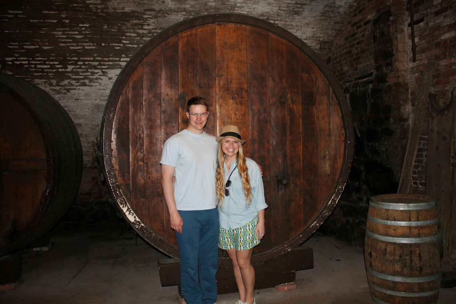 Winey children in front of a Brotherhood Winery cellar barrel